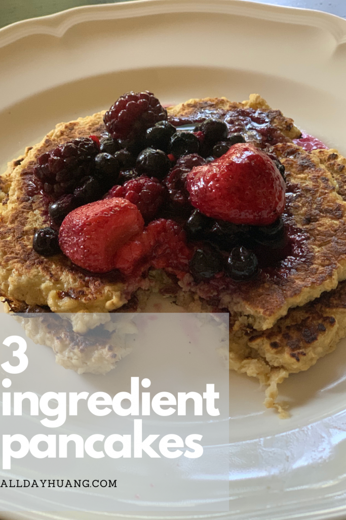 Healthy pancakes on plate with mixed berries on top