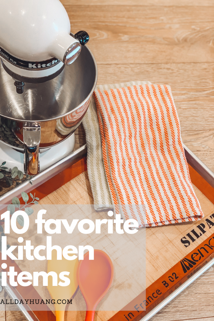 Stand mixer with dishtowels and a baking sheet.