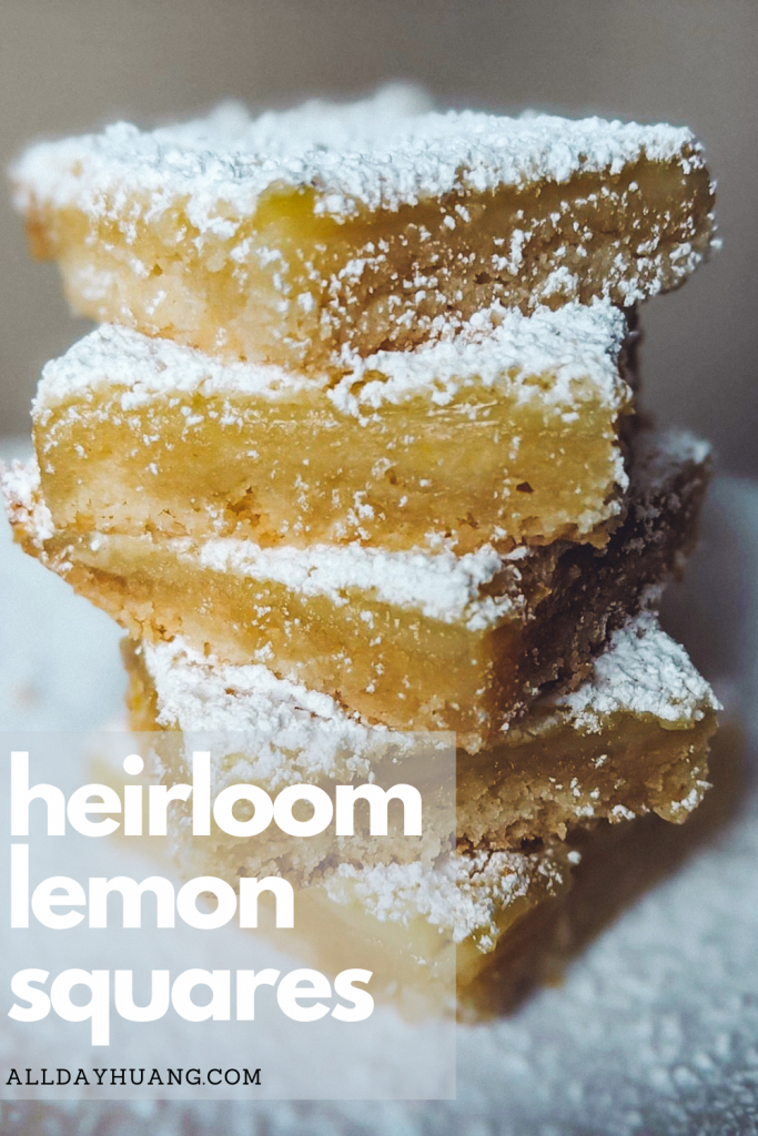 a stack of lemon squares dessert with powdered sugar sprinkled all over.